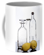 Still Life Of Bottles  And Lemons Coffee Mug
