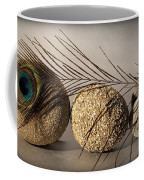 stone fish - A a peacock feather and four pebbles become a sea creature in artist mind Coffee Mug