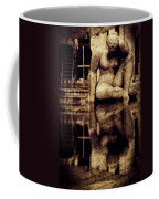 stone in reflexion - Statue reflected in a sea of doubt in vintage process Coffee Mug
