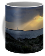 storm light - A morning light iluminates lighthouse through clouds in an amazing landscape Coffee Mug