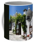 Street Scene In Alberobello Coffee Mug