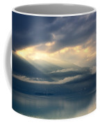 Sunlight And Clouds Over An Alpine Lake Coffee Mug