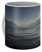 Sunlight Over An Alpine Lake Coffee Mug