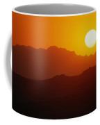 Sunset Over Silhouetted Mountain Ridges Coffee Mug