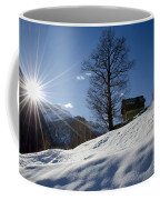 Sunshine Over The Snow Coffee Mug