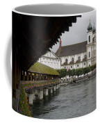 Swans Float Past The Old Town Coffee Mug by Taylor S. Kennedy