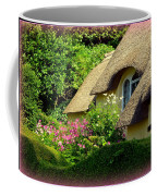 Thatched Cottage With Pink Flowers Coffee Mug