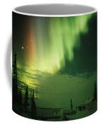 The Aurora Borealis Shimmers Coffee Mug