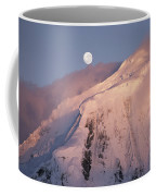 The Moon Rises Over Snow-blown Peaks Coffee Mug