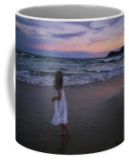 The Sun Begins To Set Over Manley Coffee Mug by Annie Griffiths