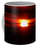 The Sun Falling Into Clouds Coffee Mug