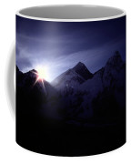 The Sun Rising Over The Snow-covered Coffee Mug