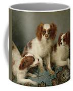 Three Cavalier King Charles Spaniels On A Rug Coffee Mug