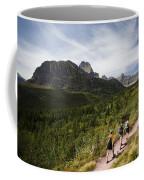 Three Hikers Walk On A Trail Coffee Mug