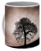 Tree Against A Stormy Sky Coffee Mug