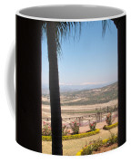 Tree Blocking View Of Garden And Valley And Ice-capped Mountains Coffee Mug