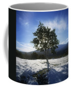 Tree On A Snow Covered Landscape Coffee Mug
