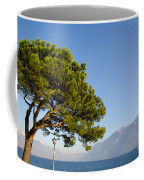 Tree Standing Close To A Lake Coffee Mug