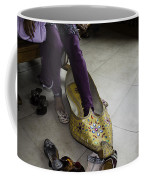 Trying On A Very Large Decorated Shoe Coffee Mug