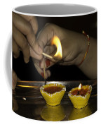 Trying To Light An Oil Lamp That Has Gone Out Coffee Mug