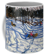 Two Boys Falling Off A Sledge Coffee Mug by Andrew Macara