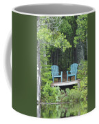Two Chairs Sit At A Lakeside Camp Coffee Mug