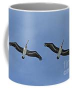 Two Pelicans In Flight Coffee Mug