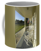 Two Rocking Chairs On A Sunlit Porch Coffee Mug by Scott Sroka