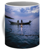 Ugandan Men Using Nets And Lanterns Coffee Mug