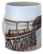 Union Pacific Locomotive Trains Riding Atop The Old Benicia-martinez Train Bridge . 5d18850 Coffee Mug