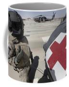 U.s. Army Crew Chief Inspects Coffee Mug