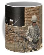 U.s. Army Soldier Configures Coffee Mug