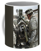 U.s. Army Soldier Loads A 105mm Coffee Mug