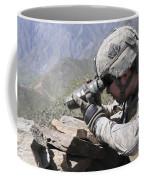 U.s. Army Soldier Monitors An Afghan Coffee Mug