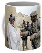 U.s. Army Soldier Shakes Hands With An Coffee Mug
