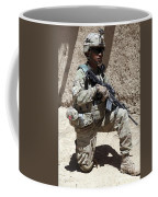 U.s. Army Soldier Takes A Knee While Coffee Mug