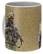 U.s. Army Specialist Talks To An Afghan Coffee Mug by Stocktrek Images