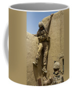 U.s. Marine Climbs Down From An Coffee Mug