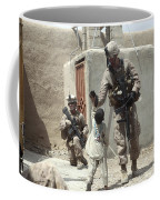 U.s. Marine Gives An Afghan Child Coffee Mug