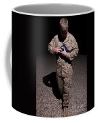 U.s. Marine Holding The American Flag Coffee Mug