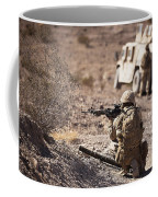U.s. Marine Scans His Area While Coffee Mug