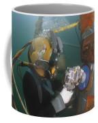 U.s. Navy Diver Uses A Grinder To File Coffee Mug by Stocktrek Images