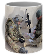 U.s. Soldiers Count Money Found While Coffee Mug