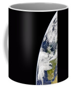 View Of Earth From Space Showing Coffee Mug by Stocktrek Images