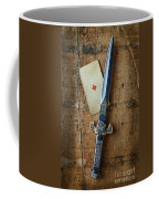 Vintage Dagger On Wood Table With Playing Card Coffee Mug