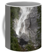 Water Cascading Down The Rock And Coffee Mug