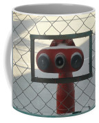 Water Hydrants Built Into A Wire Mesh Fence Coffee Mug
