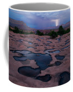 Water Puddled In The Esplanade, A Rock Coffee Mug