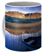 Water Reflections With Boat Coffee Mug