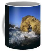 Wave Splashing Against Natural Arch Coffee Mug